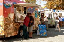 Atlanta, GA - November 17, 2012:  Unidentified customers buy food from high-end food trucks at the Atlanta Food Truck Park.